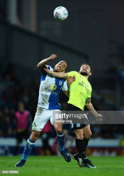 Derrick Williams of Blackburn Rovers and Danny Lloyd of Peterborough United in action during the Sky Bet League One match between Blackburn Rovers...