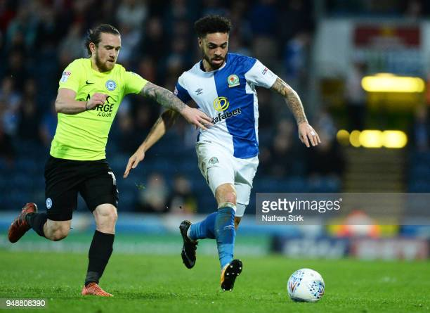 Derrick Williams of Blackburn Rovers and Jack Marriott of Peterborough United in action during the Sky Bet League One match between Blackburn Rovers...
