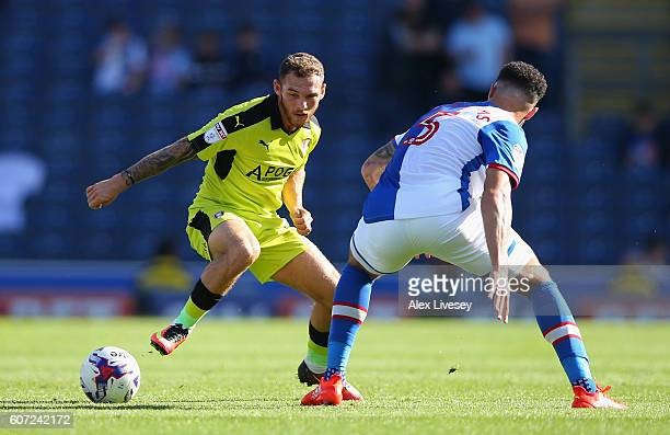 Derrick Williams of Blackburn Rovers and Jon Taylor of Rotherham United battle for the ball during the Sky Bet Championship match between Blackburn...