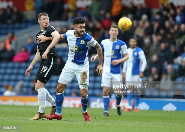 Derrick Williams of Blackburn Rovers looks to the ball with Chris Long of Northampton Town during the Sky Bet League One match between Blackburn...