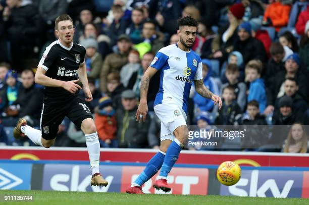 Derrick Williams of Blackburn Rovers plays the ball away from Chris Long of Northampton Town during the Sky Bet League One match between Blackburn...