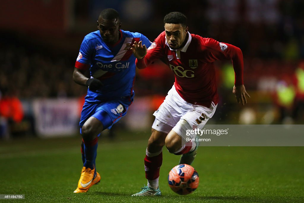 Derrick Williams of Bristol City avoids Theo Robinson of Doncaster Rovers during the FA Cup Third Round Replay between Bristol City and Doncaster Rovers at Ashton Gate on January 13, 2015 in Bristol, England.