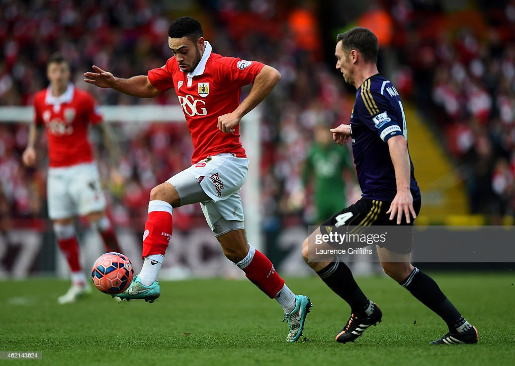 Derrick Williams of Bristol City controls the ball under pressure from Kevin Nolan of West Ham during the FA Cup Fourth Round match between Bristol City and West Ham United at Ashton Gate on January 25, 2015 in Bristol, England.