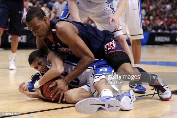 Derrick Williams of the Arizona Wildcats fights for the ball against Seth Curry of the Duke Blue Devils during the west regional semifinal of the...