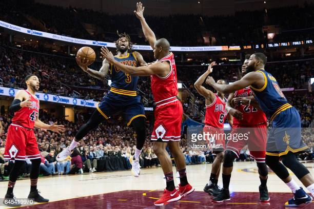 Derrick Williams of the Cleveland Cavaliers shoots over Cristiano Felicio of the Chicago Bulls during the first half at Quicken Loans Arena on...
