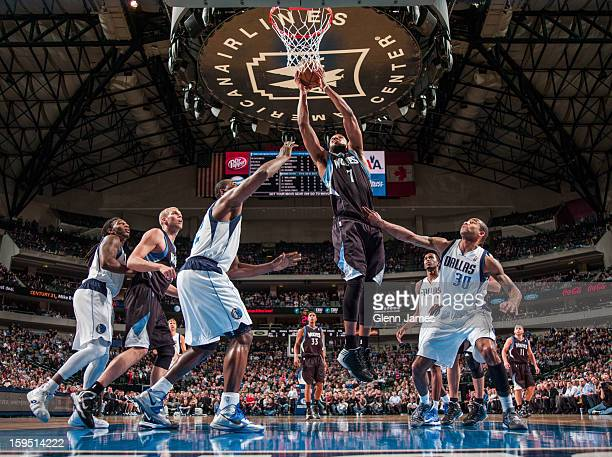 Derrick Williams of the Minnesota Timberwolves drives to the basket against Elton Brand and Dahntay Jones of the Dallas Mavericks on January 14 2013...