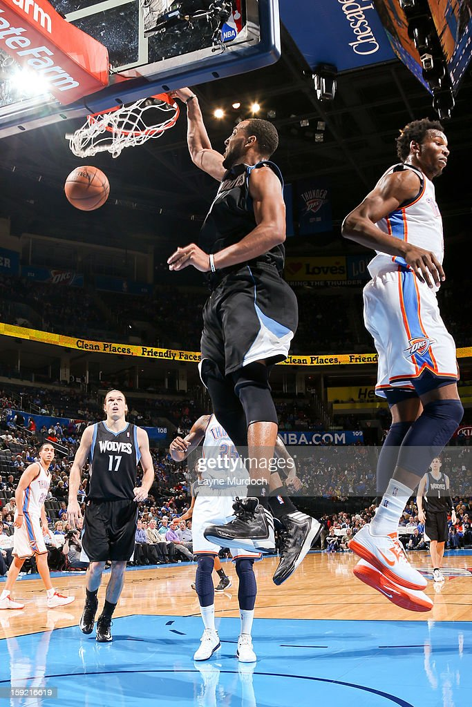 Derrick Williams #7 of the Minnesota Timberwolves dunks ahead of Hasheem Thabeet #34 of the Oklahoma City Thunder on January 9, 2013 at the Chesapeake Energy Arena in Oklahoma City, Oklahoma.