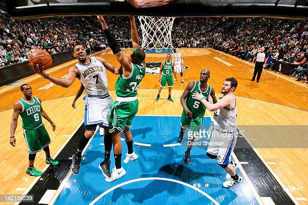 Derrick Williams of the Minnesota Timberwolves goes to the basket against Paul Pierce of the Boston Celtics on March 30 2012 at Target Center in...