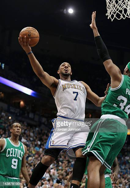 Derrick Williams of the Minnesota Timberwolves goes to the basket against Paul Pierce of the Boston Celtics during the game on March 30 2012 at...
