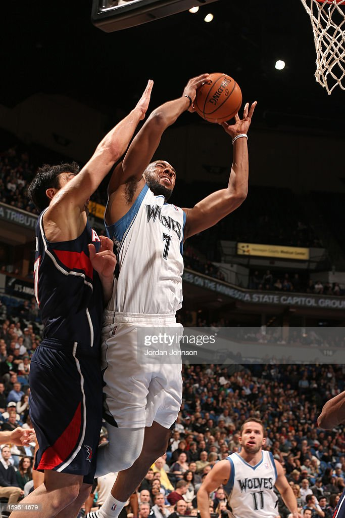Derrick Williams #7 of the Minnesota Timberwolves goes to the basket against Zaza Pachulia #27 of the Atlanta Hawks on January 8, 2013 at Target Center in Minneapolis, Minnesota.