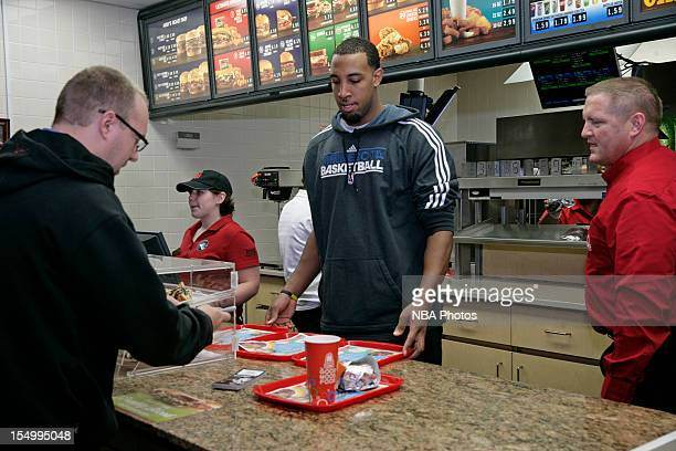 Derrick Williams of the Minnesota Timberwolves serve customers to raise money to benefit both the Arby's Foundation in support of Share our...