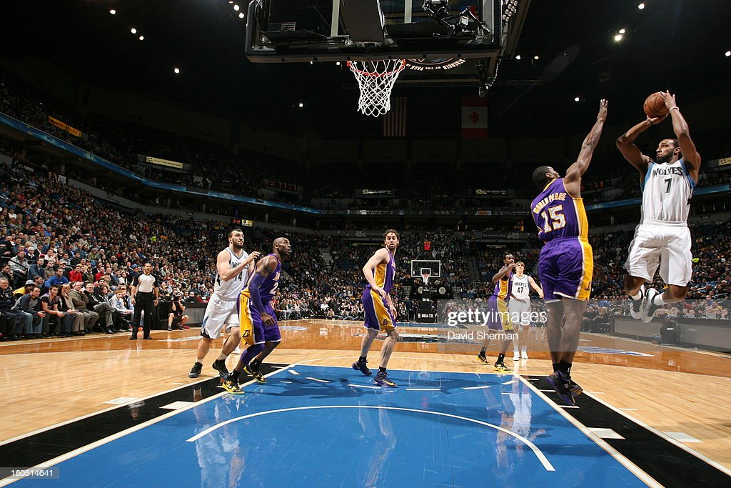 Derrick Williams #7 of the Minnesota Timberwolves shoots the ball in mid-air against Metta World Peace #15 of the Los Angeles Lakers during the game on February 1, 2013 at Target Center in Minneapolis, Minnesota.