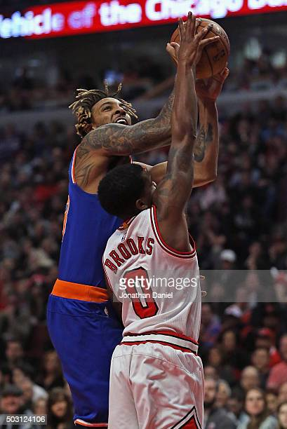 Derrick Williams of the New York Knicks is fouled while shooting by Aaron Brooks of the Chicago Bulls at the United Center on January 1, 2016 in...