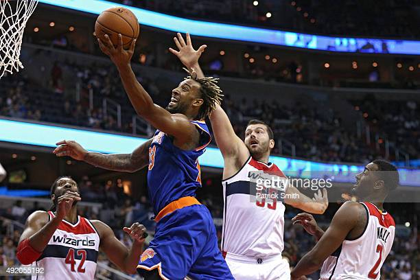 Derrick Williams of the New York Knicks puts up a shot in front of Josh Harrellson of the Washington Wizards during the first half at Verizon Center...