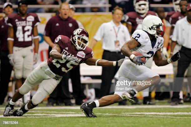 Derrick Williams of the Penn State Nittany Lions eludes the reach of Jordan Pugh of the Texas AM Aggies as he returns a punt during the Valero Alamo...