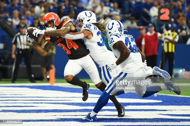 Derrick Willies of the Cleveland Browns catches a pass for a touchdown in front of Jalen Collins of the Indianapolis Colts during the second half of...