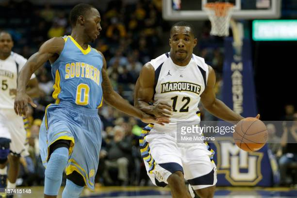 Derrick Wilson of the Golden Eagles dribbles up the court with Chrisoher Hyder of the Southern Jaguars defending during the first half of play at BMO...