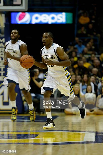 Derrick Wilson of the Marquette Golden Eagles dribbles the basketball up the court during the game against the Southern Jaguars at BMO Harris Bradley...
