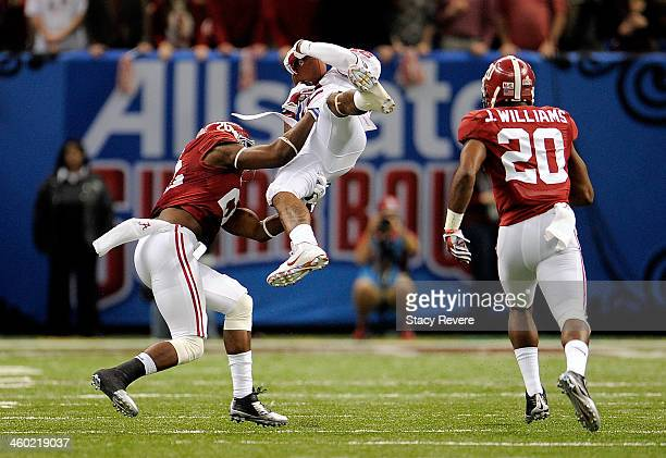Derrick Woods of the Oklahoma Sooners catches a pass as he is hit by Landon Collins of the Alabama Crimson Tide during the Allstate Sugar Bowl at the...