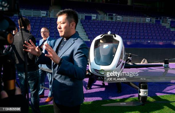 Derrick Xiong cofounder CMO of EHang speaks to journalists in front of the Air Taxi EHANG 216 during a press preview of FACC AG on Urban Air Mobility...
