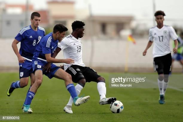 Derrik kohn of Germany in action against Ioannis Panayedes of Cyprus during the U19 International Friendly between U19 Cyprus and U19 Germany at...