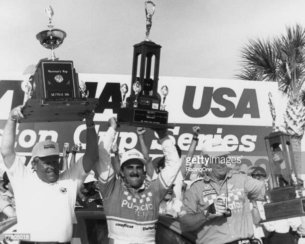Derrike Cope driver of the Chevrolet Lumina celebrates his victory of the1990 Winston Cup Daytona 500 when favorite Dale Earnhardt blew a tire on the...