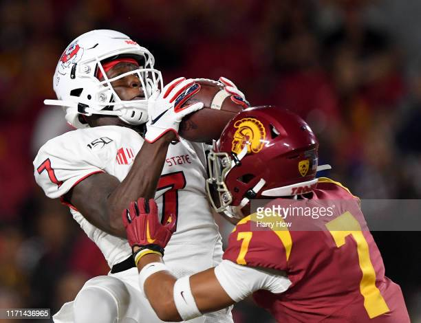 Derrion Grim of the Fresno State Bulldogs makes a catch for a touchdown in front of Chase Williams of the USC Trojans to trail 17-10 during the...