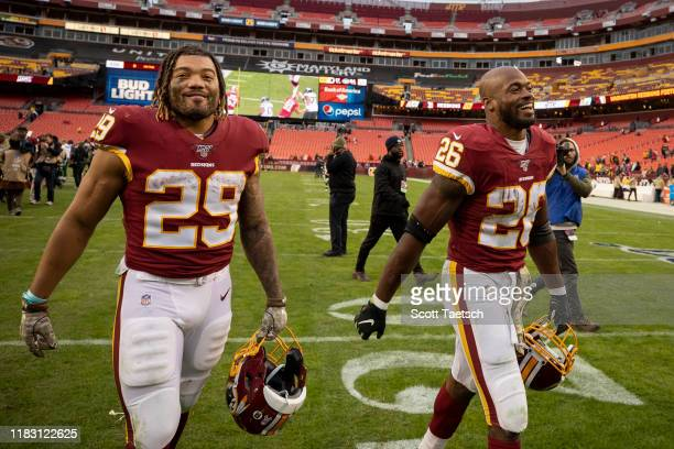 Derrius Guice and Adrian Peterson of the Washington Redskins leave the field after the game against the New York Jets at FedExField on November 17,...