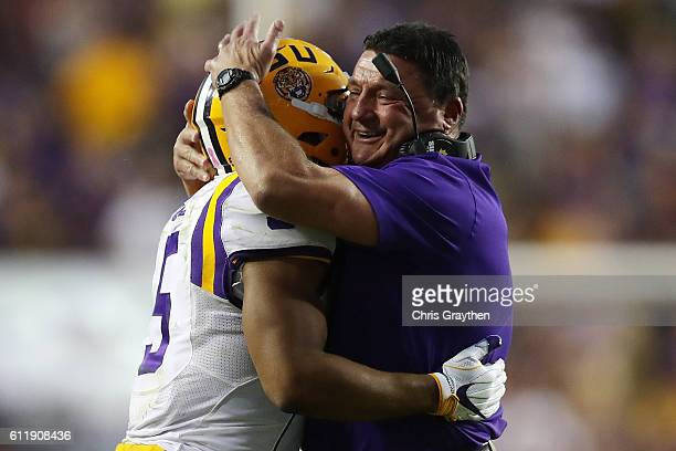 Derrius Guice hugs head coach Ed Orgeron of the LSU Tigers after a touchdown against the Missouri Tigers at Tiger Stadium on October 1, 2016 in Baton...