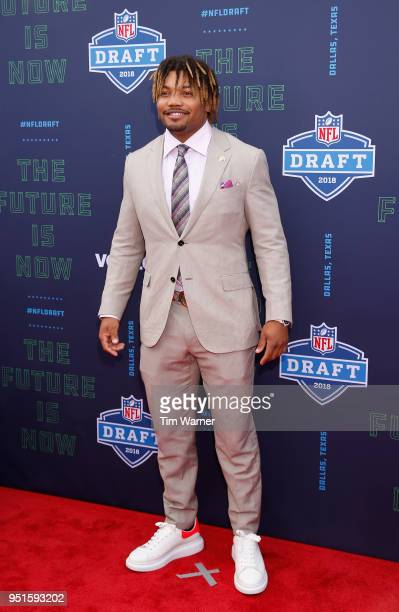 Derrius Guice of LSU poses on the red carpet prior to the start of the 2018 NFL Draft at AT&T Stadium on April 26, 2018 in Arlington, Texas.