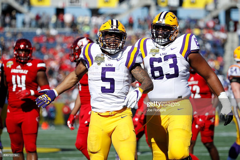 Derrius Guice #5 of the LSU Tigers celebrates after rushing for a first down against the Louisville Cardinals in the first quarter of the Buffalo Wild Wings Citrus Bowl at Camping World Stadium on December 31, 2016 in Orlando, Florida.