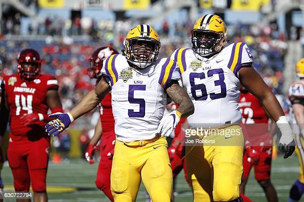 Derrius Guice of the LSU Tigers celebrates after rushing for a first down against the Louisville Cardinals in the first quarter of the Buffalo Wild...