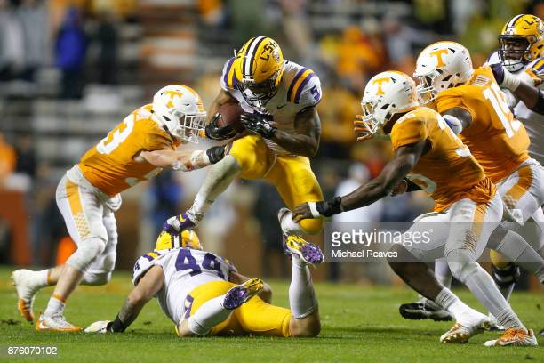 Derrius Guice of the LSU Tigers jumps through the defense against the Tennessee Volunteers during the second half at Neyland Stadium on November 18...