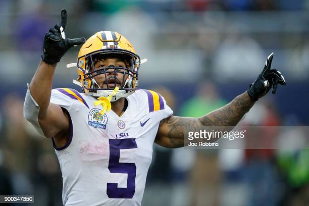 Derrius Guice of the LSU Tigers reacts after a two-yard reception for touchdown against the Notre Dame Fighting Irish in the fourth quarter of the...