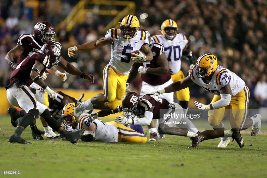 Derrius Guice #5 of the LSU Tigers runs for fist down during the second half of a game against the Texas A&M Aggies at Tiger Stadium on November 25, 2017 in Baton Rouge, Louisiana. LSU won the game 45 - 21.