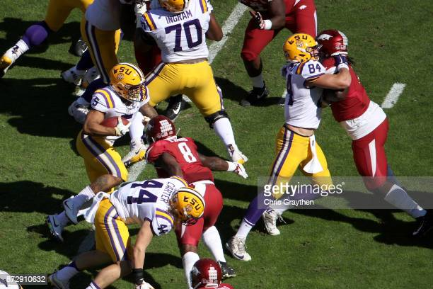 Derrius Guice of the LSU Tigers runs with the ball against the Arkansas Razorbacks at Tiger Stadium on November 11 2017 in Baton Rouge Louisiana