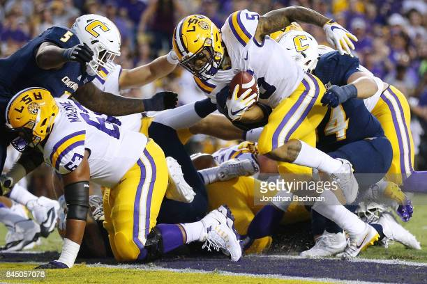Derrius Guice of the LSU Tigers scores a touchdown during the first half of a game against the Chattanooga Mocs at Tiger Stadium on September 9 2017...