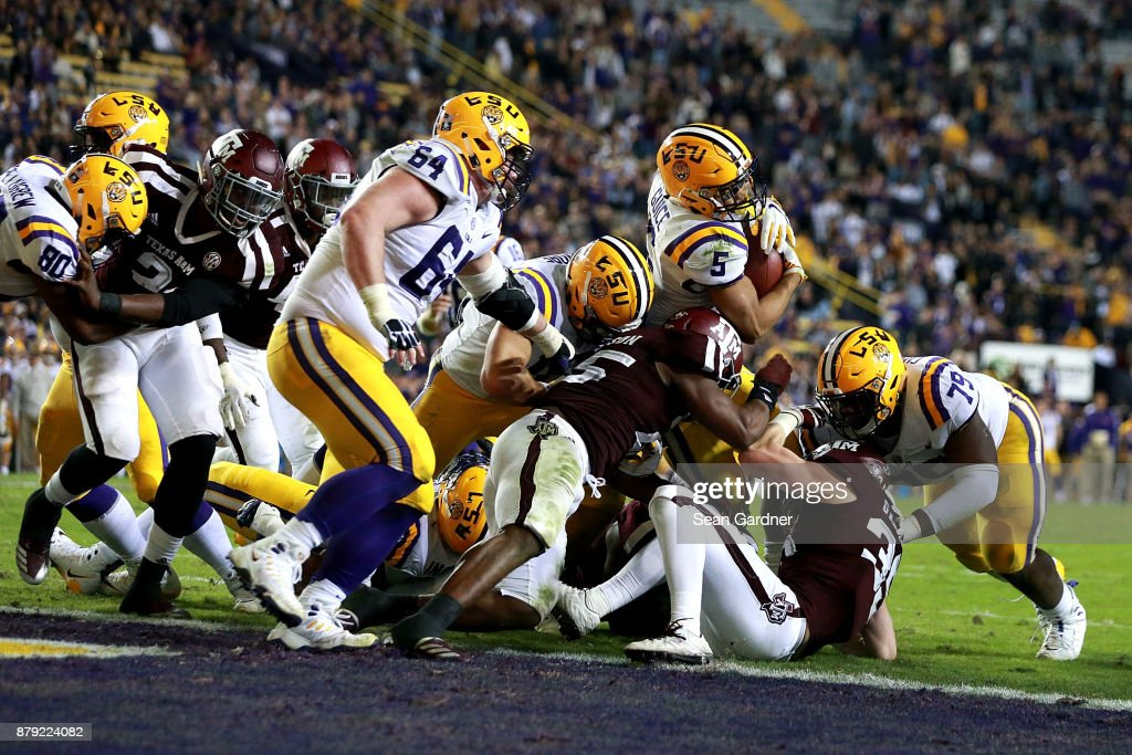 Derrius Guice #5 of the LSU Tigers scores a touchdown during the second half of a game against the Texas A&M Aggies at Tiger Stadium on November 25, 2017 in Baton Rouge, Louisiana. LSU won the game 45 - 21.