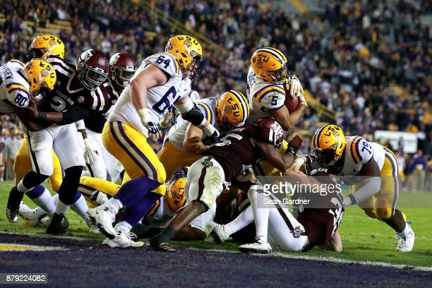 Derrius Guice of the LSU Tigers scores a touchdown during the second half of a game against the Texas AM Aggies at Tiger Stadium on November 25 2017...