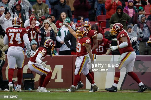 Derrius Guice of the Washington Redskins celebrates with teammates after scoring a touchdown against the New York Jets during the second half at...