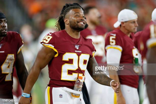Derrius Guice of the Washington Redskins laughs while standing on the sideline during the game against the Cleveland Browns at FirstEnergy Stadium on...
