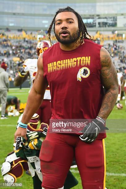 Derrius Guice of the Washington Redskins leaves the field following a game against the Green Bay Packers at Lambeau Field on December 08, 2019 in...