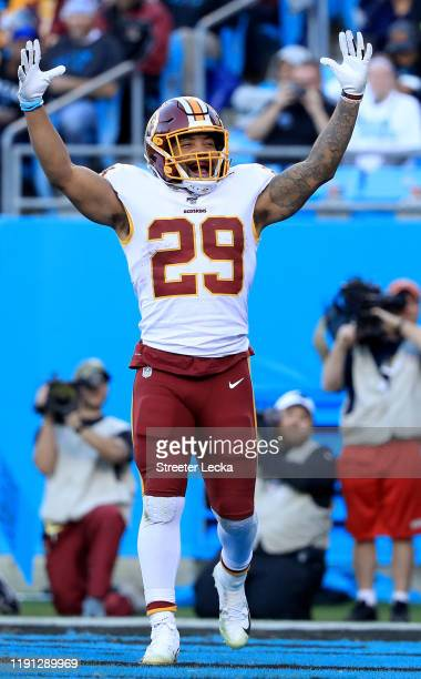 Derrius Guice of the Washington Redskins reacts after running for a touchdown against the Carolina Panthers during their game at Bank of America...