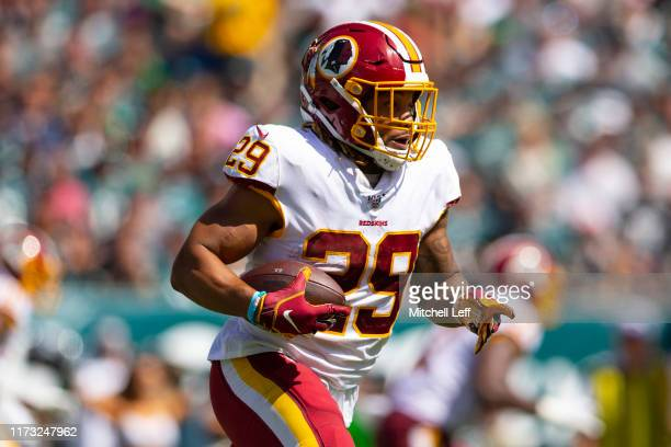 Derrius Guice of the Washington Redskins runs the ball against the Philadelphia Eagles at Lincoln Financial Field on September 8, 2019 in...