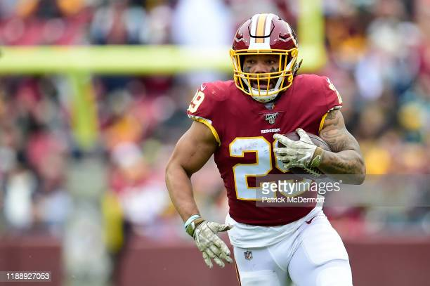 Derrius Guice of the Washington Redskins runs with the ball in the first half against the New York Jets at FedExField on November 17, 2019 in...