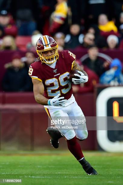 Derrius Guice of the Washington Redskins runs with the ball in the second half against the Detroit Lions at FedExField on November 24, 2019 in...