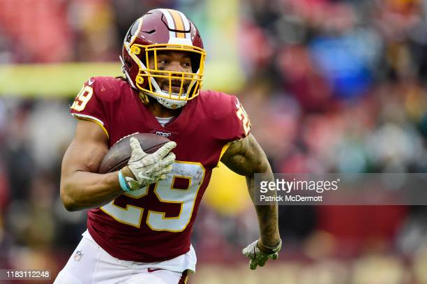 Derrius Guice of the Washington Redskins scores a 45-yard touchdown in the second half against the New York Jets at FedExField on November 17, 2019...