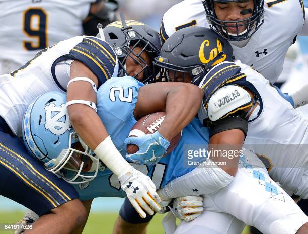 Derron Brown and Marloshawn Franklin Jr #18 of the California Golden Bears tackle Jordon Brown of the North Carolina Tar Heels during their game at...