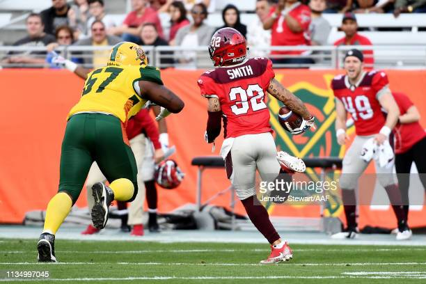 Derron Smith of the San Antonio Commanders runs with the ball after making an interception while being chased by Patrick Lewis of the Arizona...