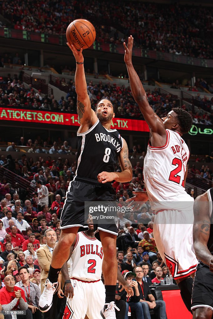 Derron Williams #8 of the Brooklyn Nets shoots against Jimmy Butler #21 of the Chicago Bulls in Game Six of the Eastern Conference Quarterfinals during the 2013 NBA Playoffs on May 2, 2013 at the United Center in Chicago, Illinois.
